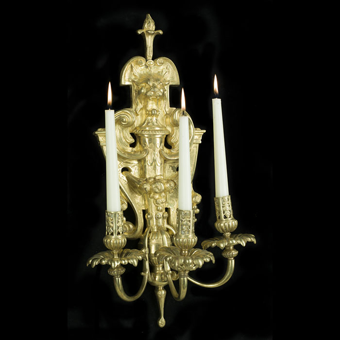 Early 20th century pair of three branch gilt bronze wall lights