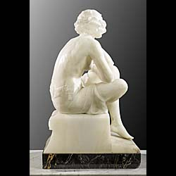 A fine statuary marble Art Deco figure of a young lady