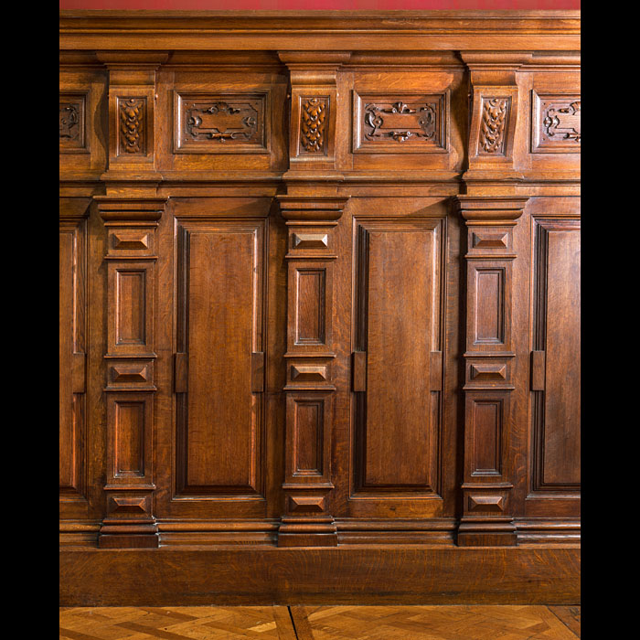 A carved oak French Panelled Room and Belgian Black Marble Chimneypiece