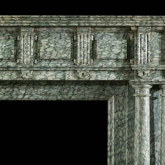 A substantial, columned antique chimneypiece in the Palladian style