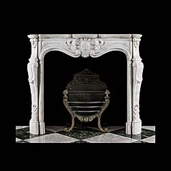 A Small French Rococo Style Marble Fireplace