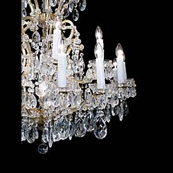 A 20th century glass and brass twenty four light large chandelier