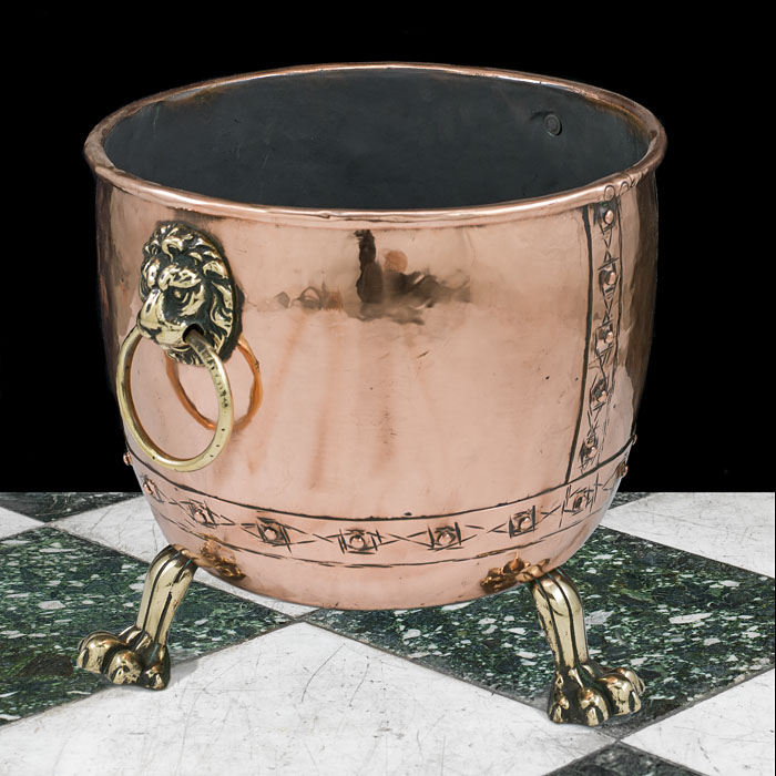 An antique Victorian lion mask copper log bin