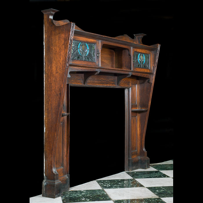 An antique oak Arts & Crafts fireplace mantel