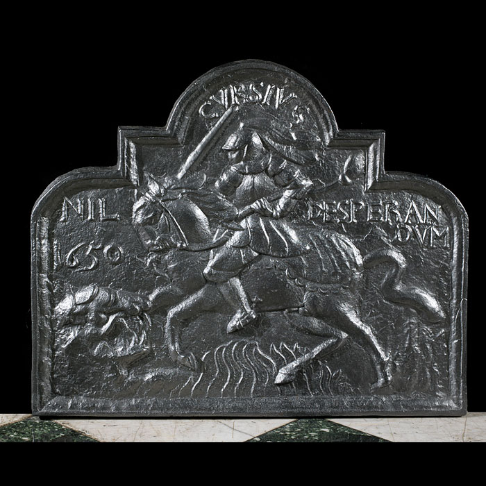 A Wealdon cast iron fireback depicting St George and the Dragon