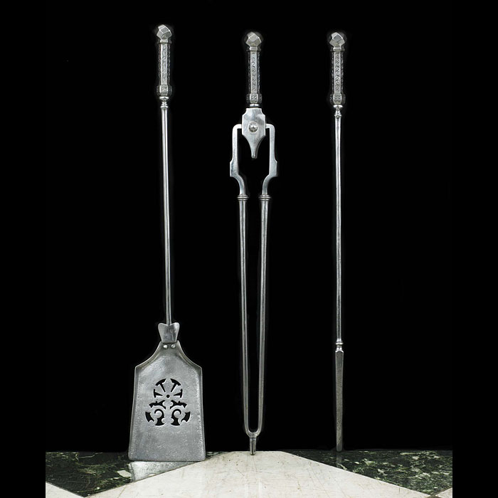 A set of three Victorian polished steel Fire Tools