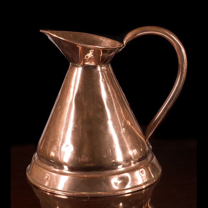Two traditional Victorian copper pouring jugs