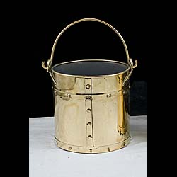 A 1930's studded brass coal or log bin
