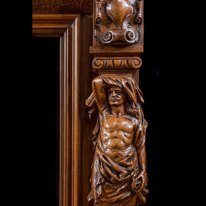A tall French Carved Walnut Wood Trumeau Fireplace