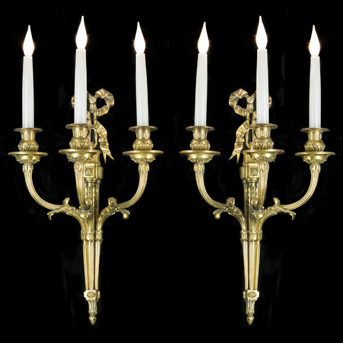 A Pair of Georgian Style Brass Wall Lights
