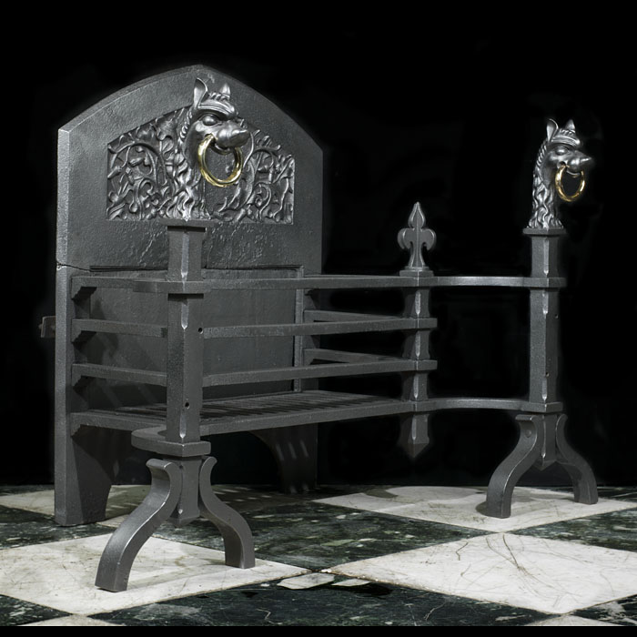 Renaissance style griffin and fleur de lys adorned Arts and Crafts Fire Grate
