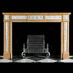 A Crema Valencia French Regency antique marble fireplace