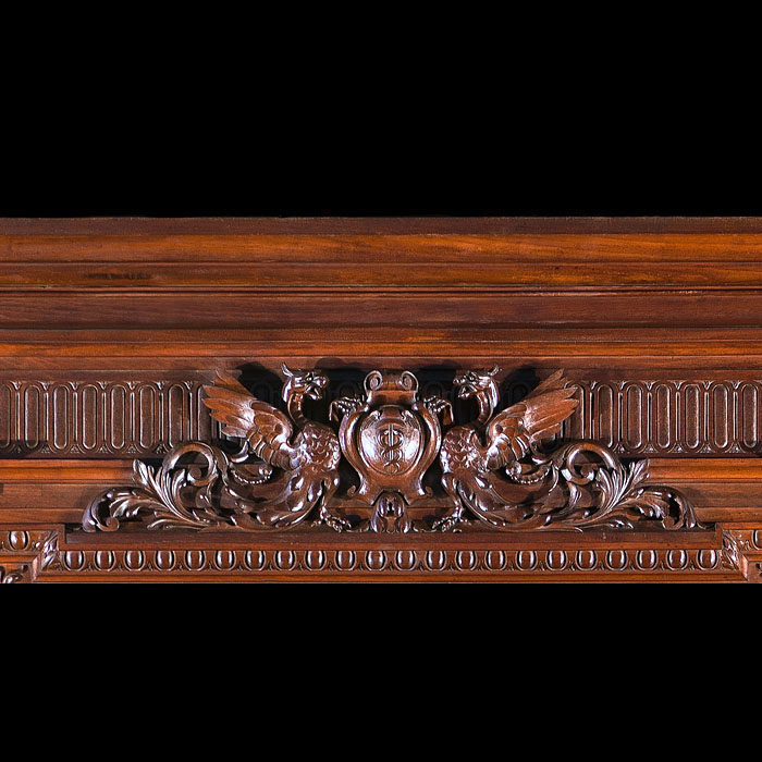 Tall and stately Renaissance style antique French walnut fireplace and  overmantel