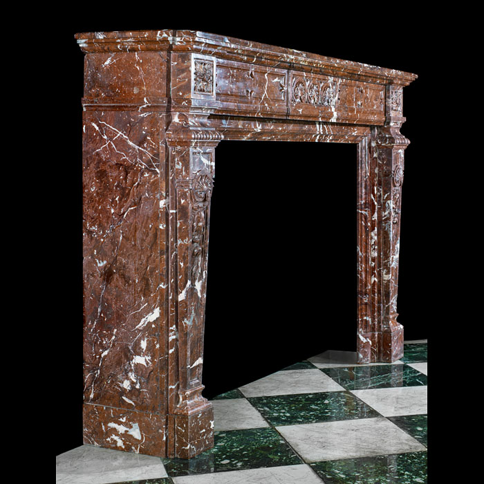 A large Belgian Griotte red veined marble antiqueVictorian fireplace