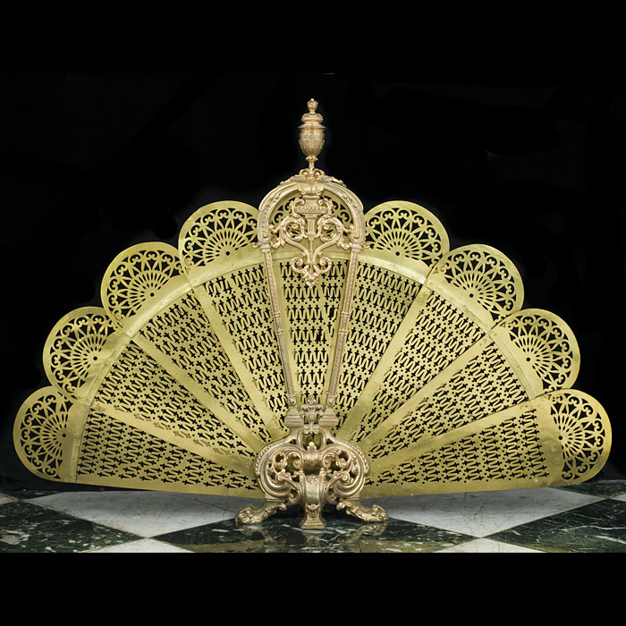 A cut brass Rococo style peacock fan fire guard