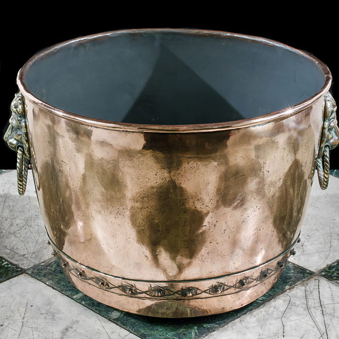A large Victorian copper and brass log bin