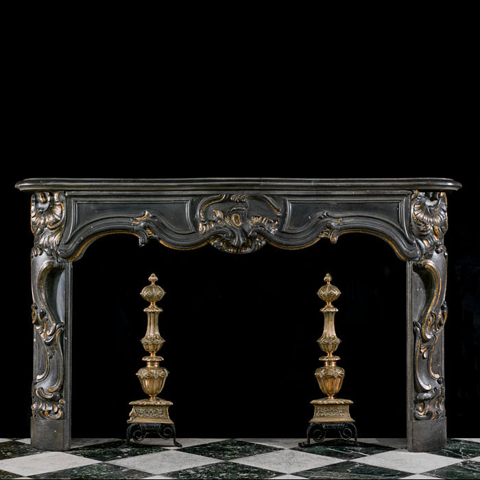 A Rococo style deeply carved Belgian Blue Stone antique fireplace