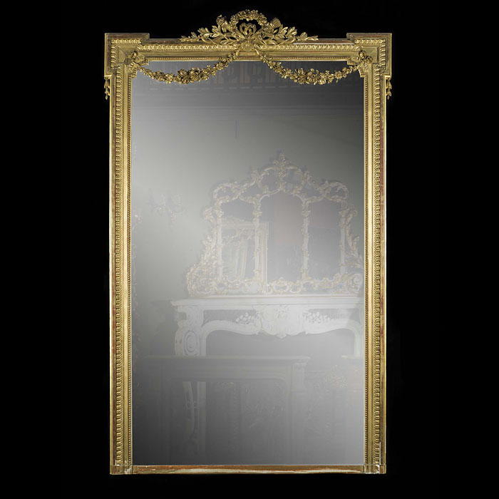 Tall French carved wood antique overmantel mirror.