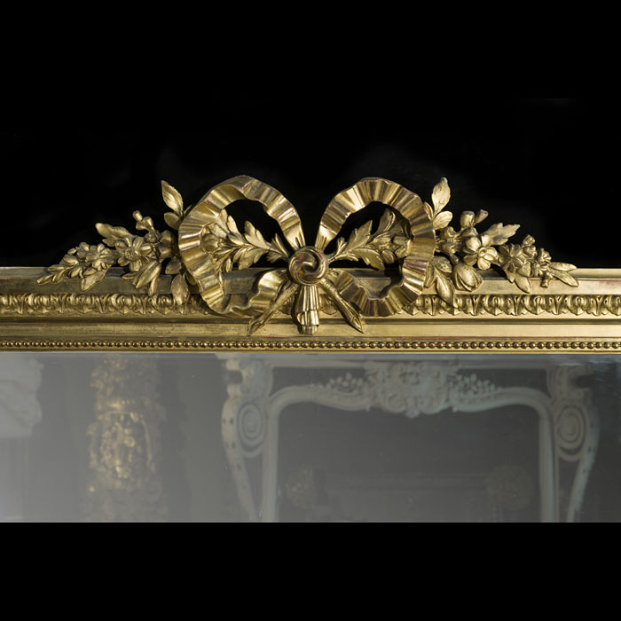 An antique carved and gilded French overmantle mirror