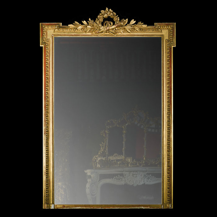 A gilded classical style antique overmantle mirror
