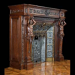A large French carved Oak Renaissance style fireplace and insert.