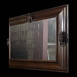 An antique oak large overmantle mirror