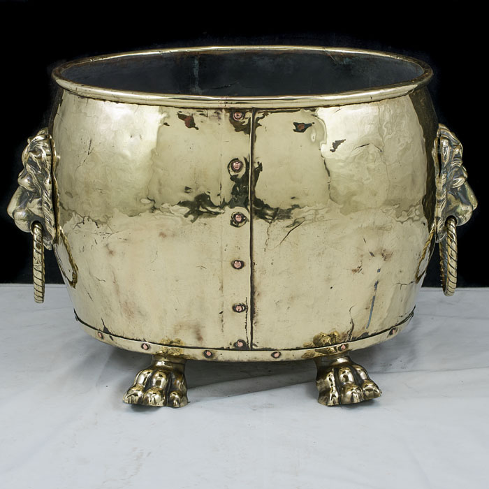 An Edwardian brass lion mask log bin