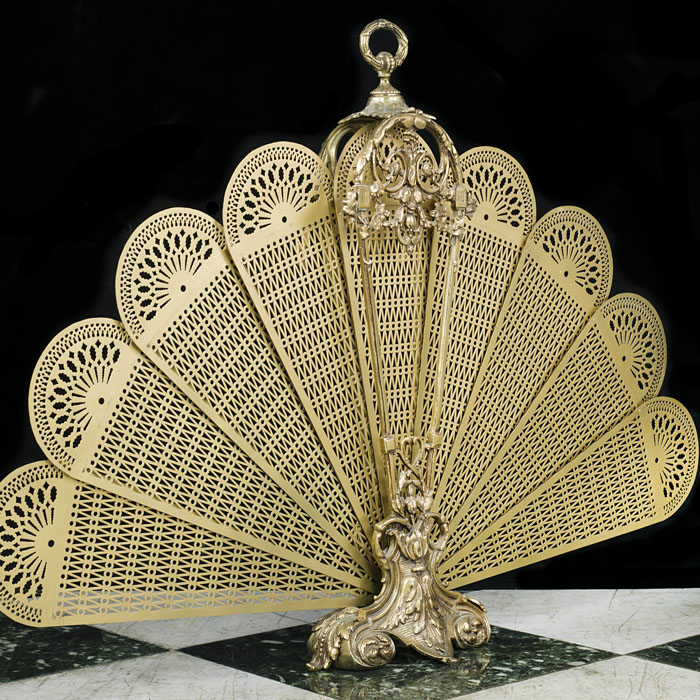 A 20th century cut brass peacock fire screen