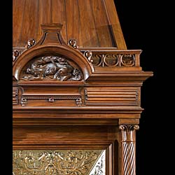 A Renaissance style columned, carved Walnut trumeau fireplace.