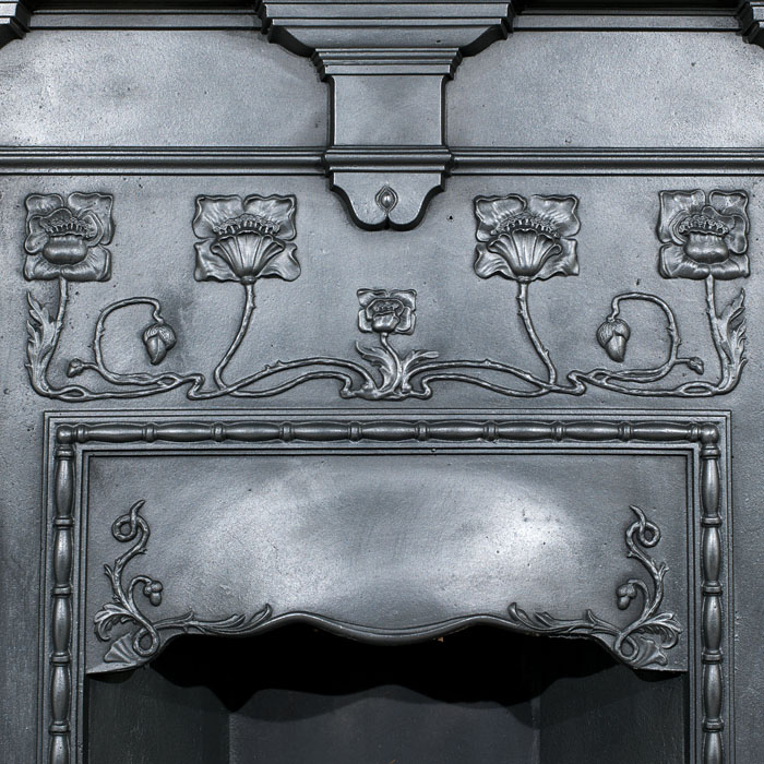 A small cast iron Art Nouveau antique fireplace surround