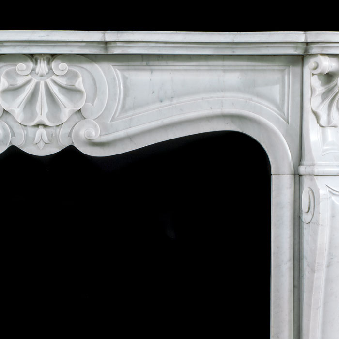 A late 19th century French Rococo style marble fireplace mantel