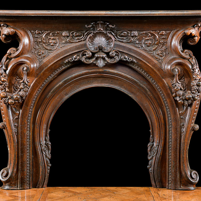 A Cast Iron Rococo Style Fireplace Surround