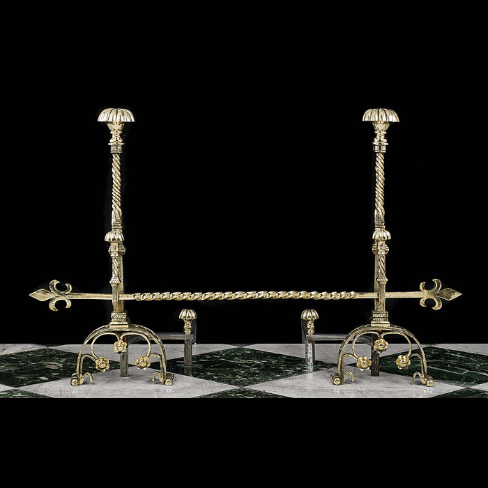 A pair of tall etched brass Baroque style Andirons