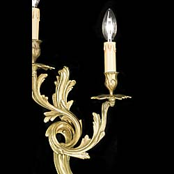 A 20th century pair of Rococo style wall lights