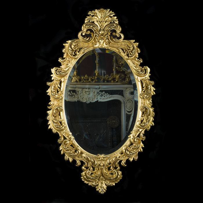 An Ornate Rococo Style Giltwood Wall Mirror