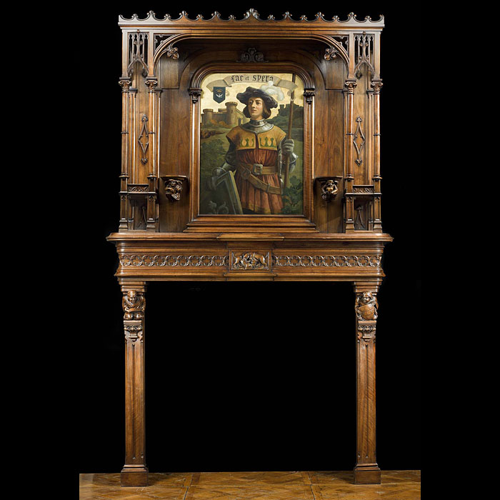 A carved walnut Gothic Revival fireplace and over mantel