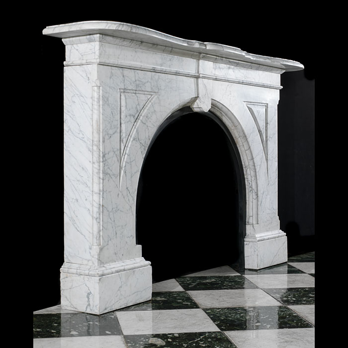 A Victorian arched fireplace surround in Pencil Statuary Marble