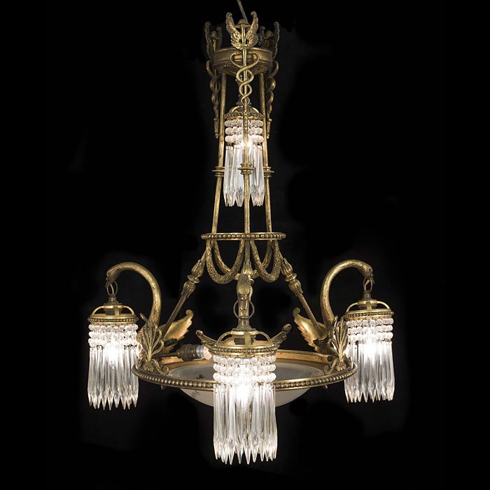 A gilt brass Empire style swan chandelier