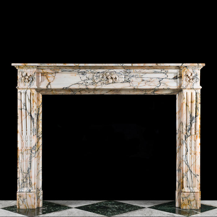 A Louis XVI style Skyros Marble antique fireplace mantel