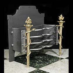 Early 20th century cast iron and brass antique fire grate