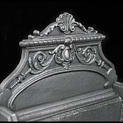 A Victorian cast iron and brass Rococo style fire basket
