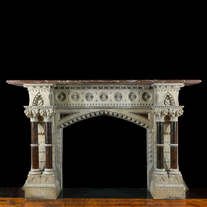 A Victorian Gothic Revival stone and marble antique fireplace mantel