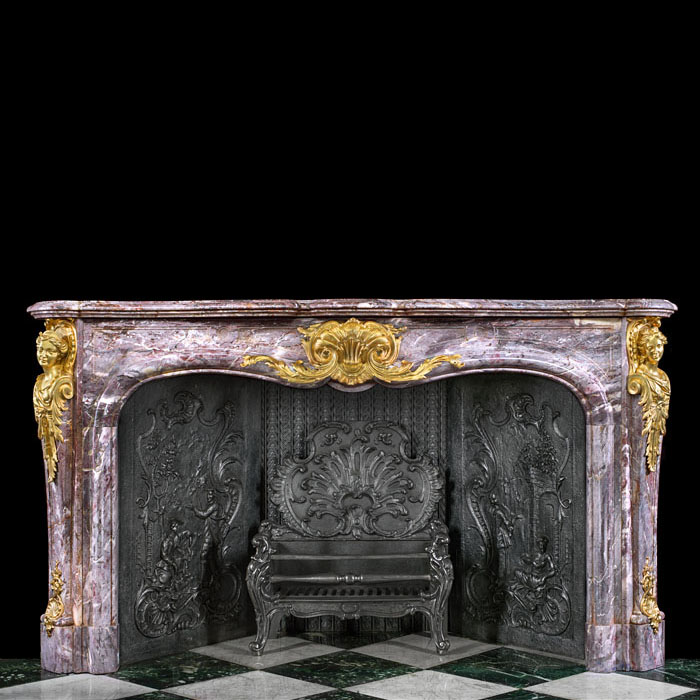 A grand Rococo style ormolu mounted antique marble fireplace surround