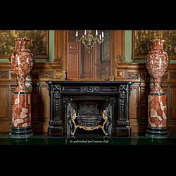 Monumental pair of lion mask Scagliola urns raised on matching plinths