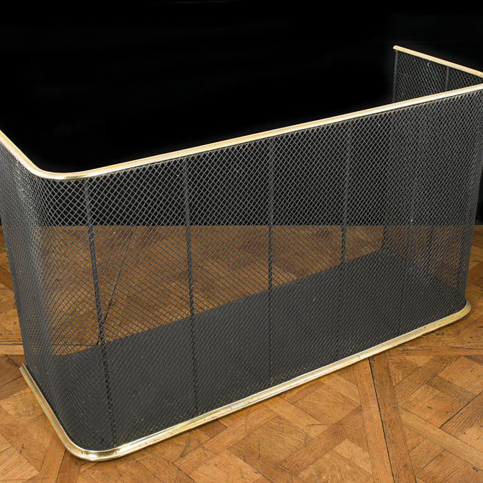 A brass and wire mesh Victorian nursery fireplace fender
