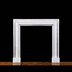 A Carrara Marble bolection fire surround