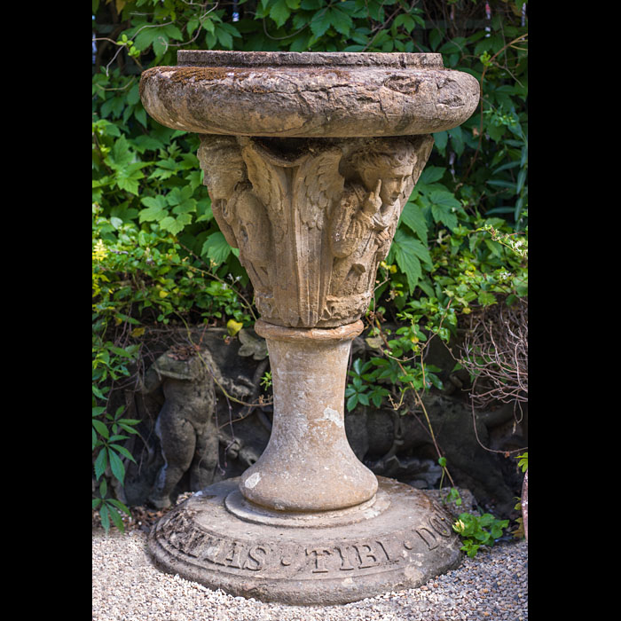 A 19th century carved stone bird bath