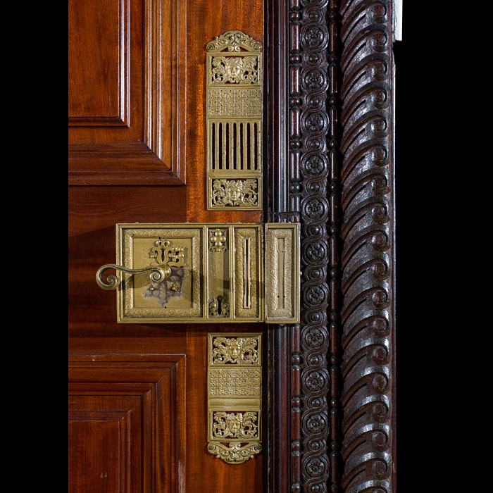 A pair of Victorian walnut doors with marquetry panels
