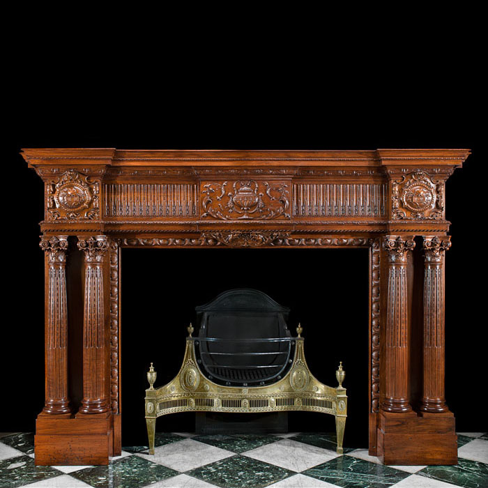 A fine twin columned walnut Victorian fireplace surround in the Palladian manner
