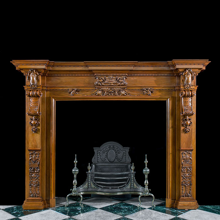 A grand carved walnut Victorian fireplace mantel